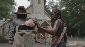 As Gabriel takes a rest, Michonne touches Juith's sleeping head (and that, my readers, is all a stunt baby should be expected to do...look adorable, and take a nap!).