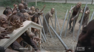 Thankfully for Gabriel, the Morgan-style spikes that Daryl and Tyrese fashioned from the organ pipes hold the walkers off, buying him a couple of minutes' worth of time...