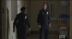officer OD challenges beth as dawn walks past percy