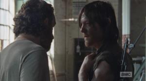 Rick pulls Daryl aside.
