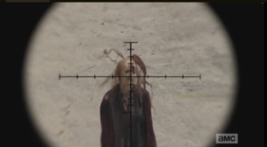 In reply, a perfectly placed shot by Sasha, sniper style, takes out the walker behind them.