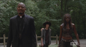 As the walkers begin to break down the doors, Gabriel, Michonne, and Carl back up...Carl asks,