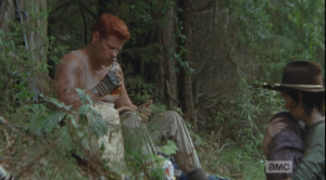 Abraham sniffs the bottle, then takes a drink.