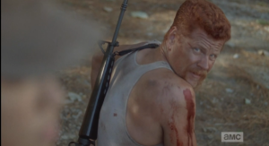 Abraham sneaks a look at her face, but Rosita does not turn to look at him. After a moment, she walks away.