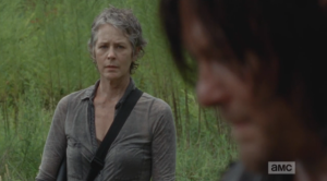 Carol looks at Daryl.