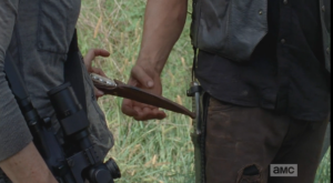 carol hands daryl beth's knife