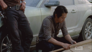 This image, of Glenn holding this baseball bat, is considered a potential