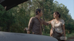 Glenn steps up, reaches a hand out to Maggie and stops her from shooting the lock.  When Maggie tells him about the walker in the trunk, Glenn steps forward, manages to get the trunk open, and rekills the walker with a knife to its head.  He then turns to Maggie, and gently says,