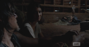 Maggie thanks Daryl, smiling sweetly at him, and then gets up, music box in hand, and goes over to wake up Sasha.