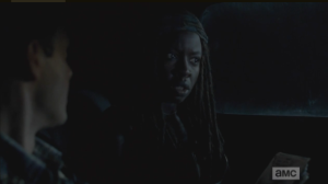 Michonne knows immediately that Aaron is lying, and looks to the front seat, asks Rick,