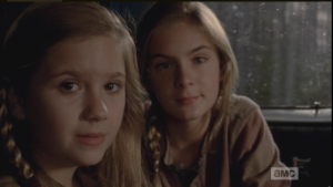 Mika and Lizzie are riding in the back with Tyreese. Their wounds, and blood, are gone now too.
