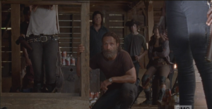 Rick crouches down, looks right at Aaron.