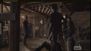 After the volunteer troupe leaves, Rick turns to the others, says that if they're all in the barn, they're a target. He orders them outside, in groups of twos, within eyeshot. Daryl tells him he's got the area covered. They file out, leaving Rick, Aaron, and Judith in the barn.