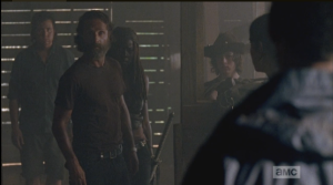 Aaron, of course, does, says nothing about Rick's taking his gun. Rick asks Aaron, softly,