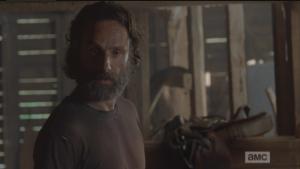 Rick looks down at Aaron, retorts,
