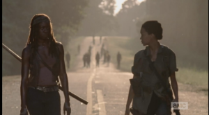 Sasha looks back at the walkers, then at Michonne, tells Michonne,
