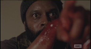 Tyreese points his bloody arm, finger, at the Gov.