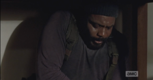 tyreese sweating, looking at his wound