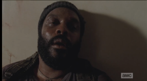 Tyreese, fading out, sees Mika and Lizzie sitting in front of him.