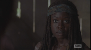 Michonne's face softens.