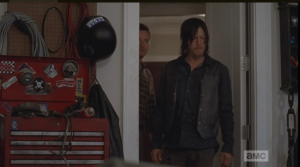 In reply, Aaron brings Daryl to the garage, which is stocked with tools, a motorcycle frame, and many, many parts.  Aaron explains that the frame and the tools were there already, that whoever lived here, before, must have built bikes.