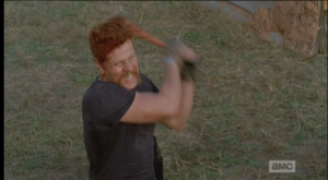Abraham continues to singlehandedly massacre the oncoming walkers, armed with only a wrench-sized metal stick.