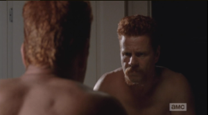 Meanwhile, Abraham stands at the bathroom mirror...