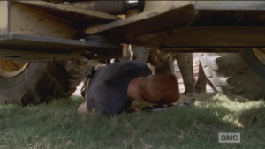 ...while Abraham quickly slides under truck, taking momentary cover there...