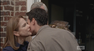 Aiden kisses his mom and bids his father farewell.