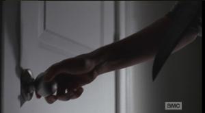 carl at the door, knife