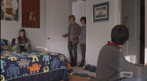 In Rowan's room, two teens, a boy and a girl, are hanging out. Rowan introduces Carl to