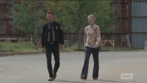 Carol excuses herself, seeing Rick, telling the other JL ladies that she needs to ask him for his help with the party.  As they walk together, Rick and Carol agree that tonight would be the night to break into the armory, as everyone will be at the party.