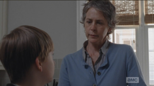 Carol asks Sam who the gun is for. He doesn't answer.