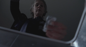 Before going into the armory, Carol opens the freezer and helps herself to another bar of chocolate...Carol, Carol, Carol, Olivia may not notice a few missing handguns, but I have a feeling she sure as hell will notice missing bars of chocolate!