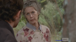 Carol turns to Rick, tells him that