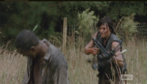 Daryl spears a walker's head and rushes in. Aaron follows suit...