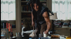 Daryl is leaned over, fiddling with some polished stones, or dice, or something on Deanna's desk.  We hear Deanna's voice, through the recorder,
