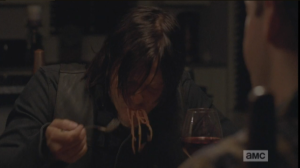 Speaking of pained looks, back at Aaron and Eric's, Daryl is shoveling spaghetti into his mouth, slurping the noodles noisily...