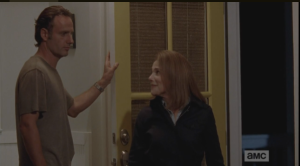 Deanna looks at Rick, smiling.
