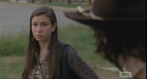 Carl looks over at Enid, who is watching him.  They regard each other for a moment, and then Carl asks her,
