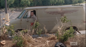 Eugene, who has gotten Tara to the van and who pulls up, slapping the door and calling the walkers away,