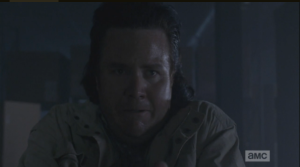 Terrified, Eugene backs away from the advancing walker...