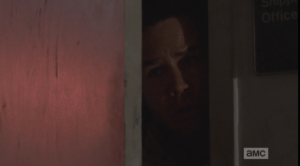 ...and the next shot we see is of Eugene, peering fearfully out the office door...