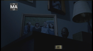 WD Ep 513 opens before the sun rises another day in Alexandria: Vanilla Dream.  In the predawn darkness, we see framed pics of white people arm in arm, or trying to look casual and unscripted while posturing themselves in wacky antics for the camera.