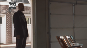 We see Father Gabriel step into a garage that has been converted into a church.
