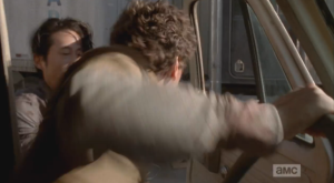 Glenn runs up and grabs Nicholas out of the van...
