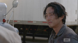 Glenn looks at Eugene, too distraught to answer. His look, and his red, swollen eyes say it all. He walks away.