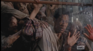 Noah gets thrown up on the glass of the door by the walkers. The expression on his face as he looks at Glenn is agonizing to watch.