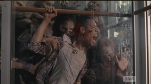 The walkers begin to bite into poor Noah's flesh as he screams in agony.