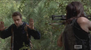 Meanwhile, as Daryl prowls through the woods, crossbow in hand, he hears and noise, whirls.
